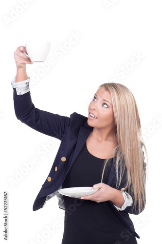 Attractive blonde holding teacup and saucer