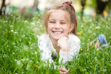 adorable little girl on the meadow