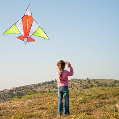 little girl flies a kite