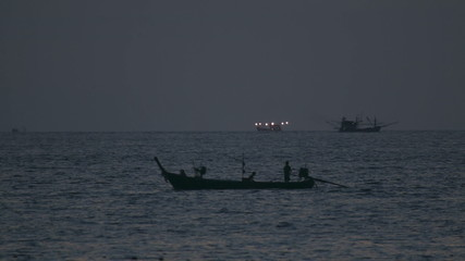 Fishing boats returning to the port at dusk.