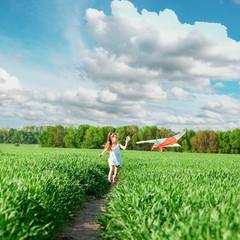 cute little girl flies a kite