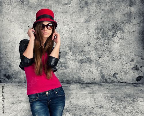sexy stylish girl. Gray concrete wall