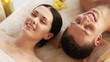 happy couple relaxing in spa salon