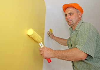 Senior man painting, interior decoration