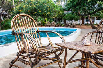 Chairs on swimming pool border