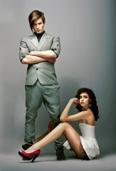 Flirt. Lifestyle. Man with Crossed Arms and Gorgeous Woman