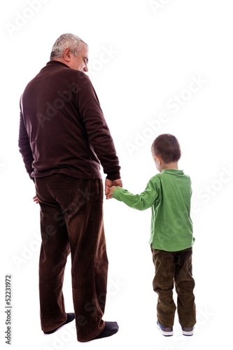 Senior man holding his grandson's hand, back view
