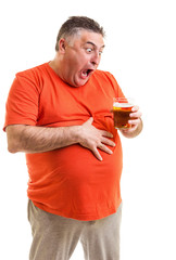 Portrait of a thirsty fat man staring at a glass of beer