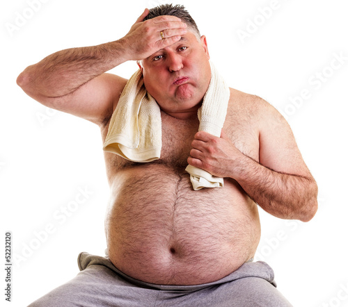Overweight man resting, tired after training, with hand on foreh