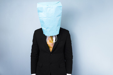Ashamed businessman with bag over his head