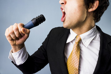 Businessman singing karaoke