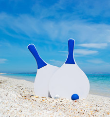 white and blue beach rackets