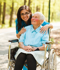 Woman in Wheelchair and a Nurse