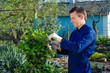 Young man pruning ivy