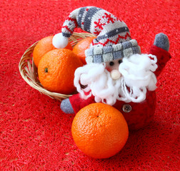 Mandarins and toy gnome