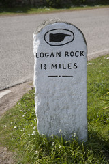 Milestone marker pointing to Logan Rock Cornwall England UK