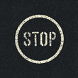 Stop sign painted on a asphalt road. Vector