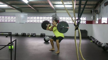 Athlete doing squat clean, push press crossfit fitness