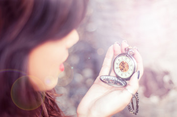 Woman checking a pocket watch
