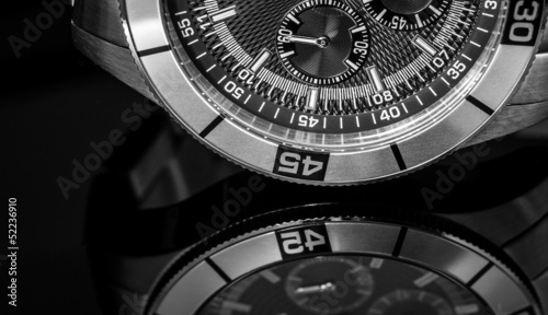 Luxury Watch over reflective surface, selective focus