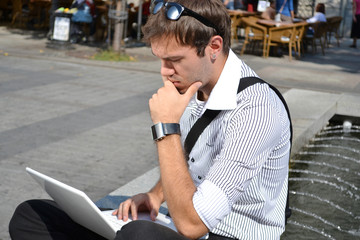 young businessman thinking and planing outdoor