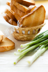 rusks of white bread in a wicker bread bins