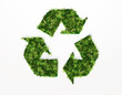 recycling symbol covered by grass and flowers