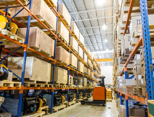 Modern warehouse with forklifts