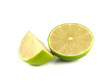 Isolated green lime with slice on white