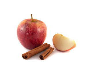 Isolated red apple with slices and cinnamon