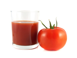Red ripe tomato with glass of tomato juice