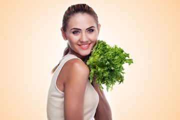 woman with bundle herbs (salad). Concept vegetarian dieting - he