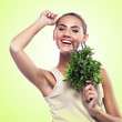 woman with bundle herbs (salat). Concept vegetarian dieting