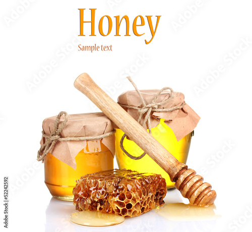 Two jars of honey and honeycombs isolated on white
