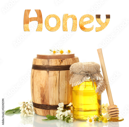 Sweet honey in jar and barrel with acacia flowers isolated