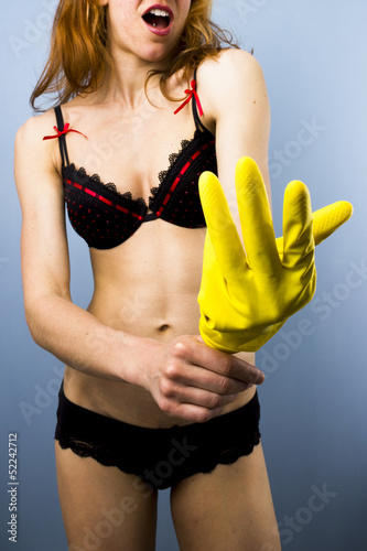Sexy pinup putting on glove