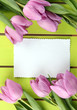Beautiful bouquet of purple tulips and blank card