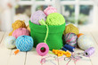 Colorful yarn for knitting in green basket - 52243174