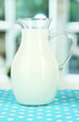 Pitcher of milk on table in room