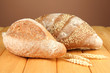 Composition with bread on wooden table, on color background