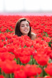 beauty young woman with flowers tulips