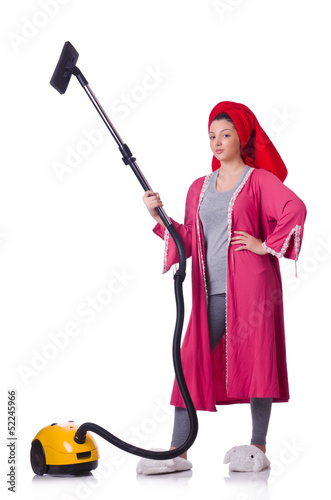 Woman working with vacuum cleaner on white