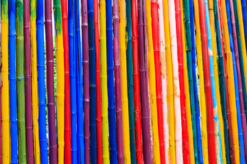 Abstract texture of dyed bamboo sticks.