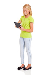 cute preteen girl using tablet computer