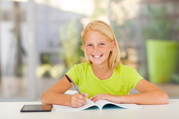cute teen girl doing homework