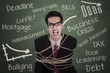 Angry businessman tied with rope in class