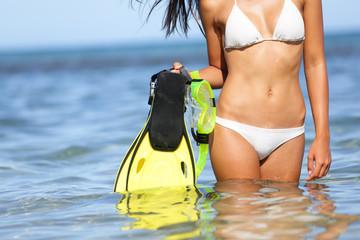 Travel beach fun concept - woman snorkeling fins
