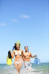 Travel beach vacation people - happy couple fun