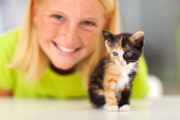 cute little kitten and teen girl
