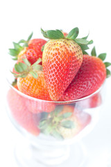 big red strawberries in a glass bowl